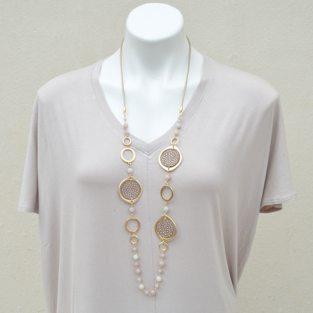 gold loop with skin disc necklace