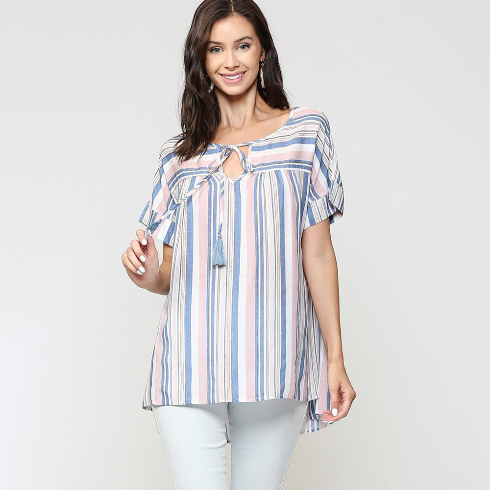 light mauve striped peasant top with tassel trim