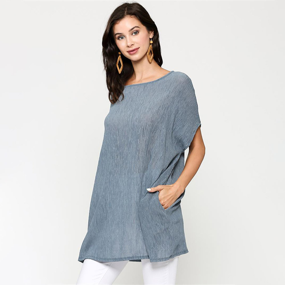 dusty blue oversized top with dolman sleeves and pockets