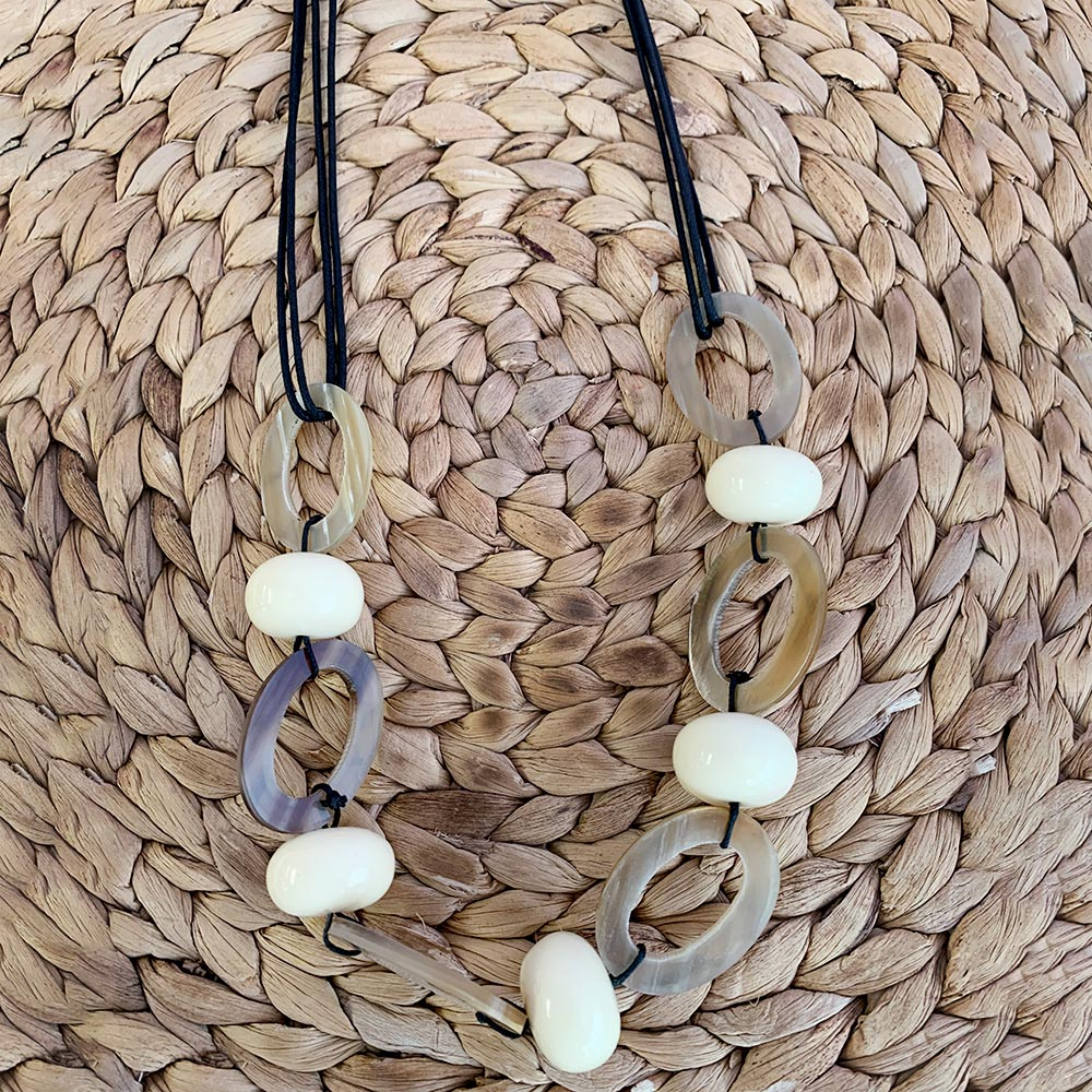 hahn loop and cream bead on black cord necklace