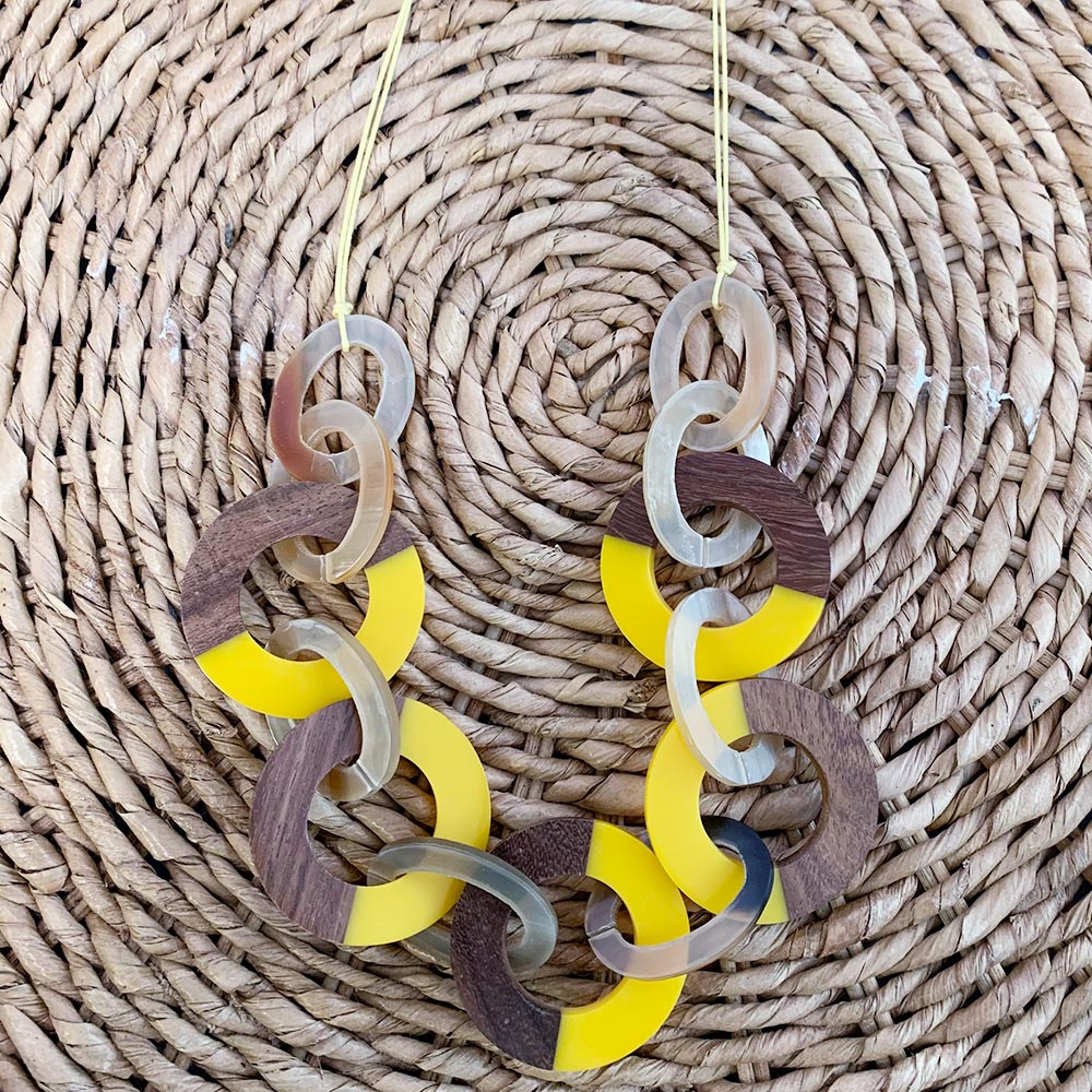 wood circle necklace with yellow accents