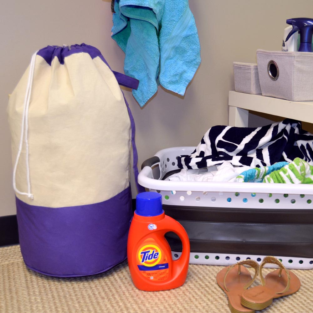 natural duffle bag with purple trim