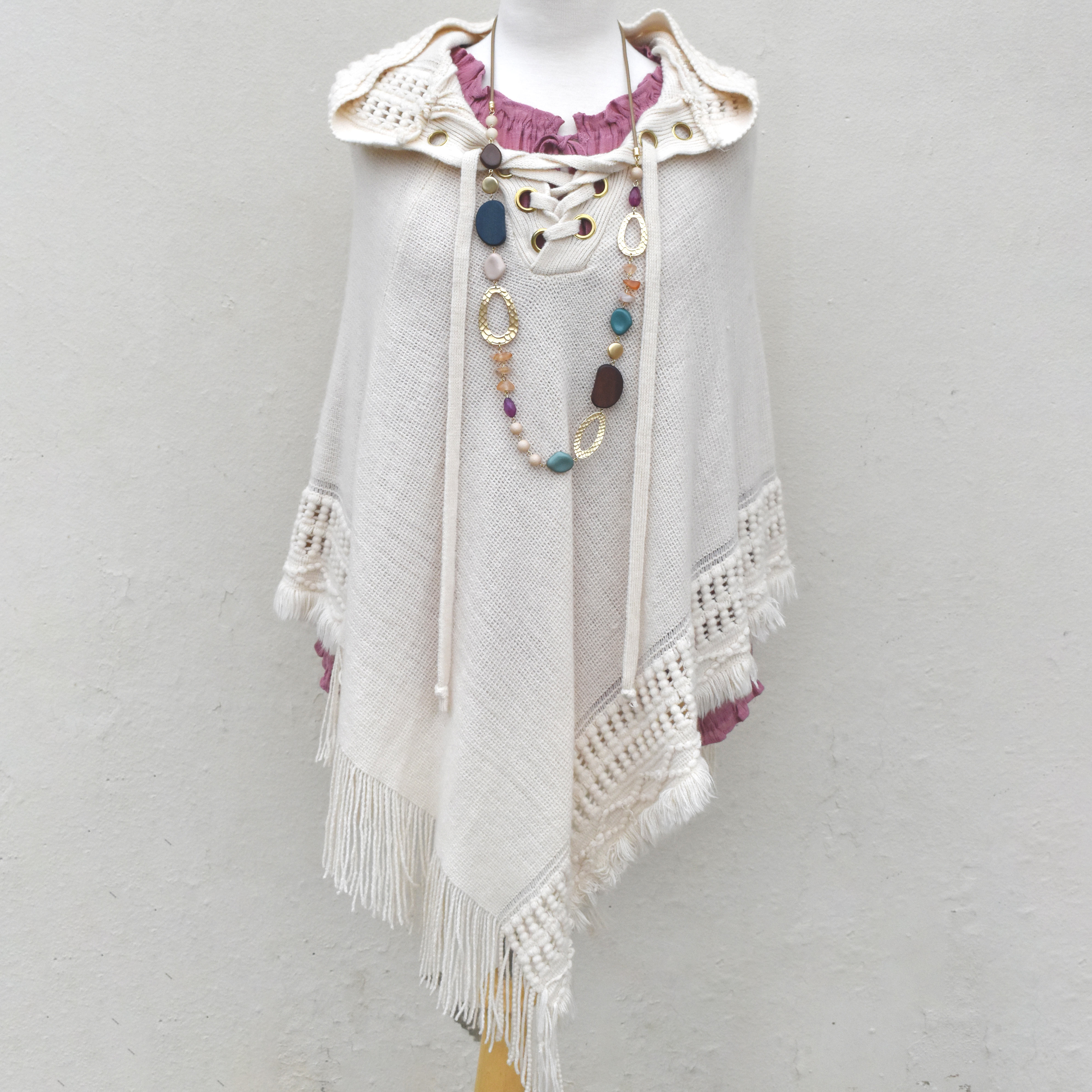 knit poncho with lace up front and hoodie cream