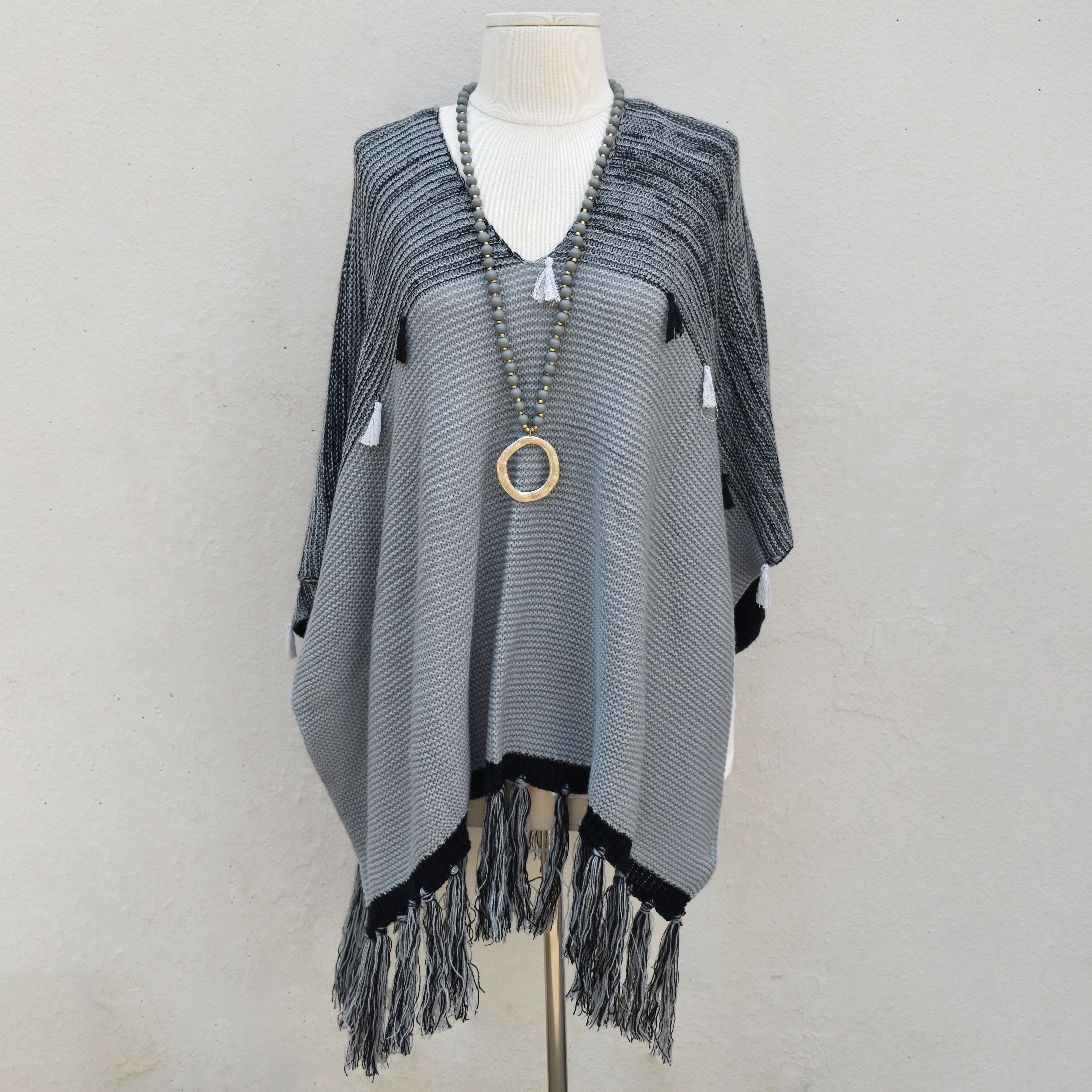knit poncho with tassel detail grey/black