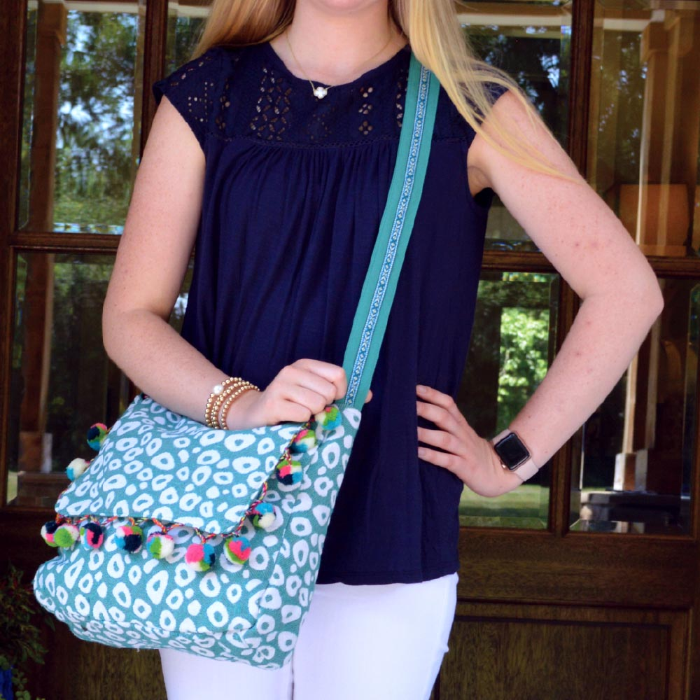 durry teal spots messenger bag