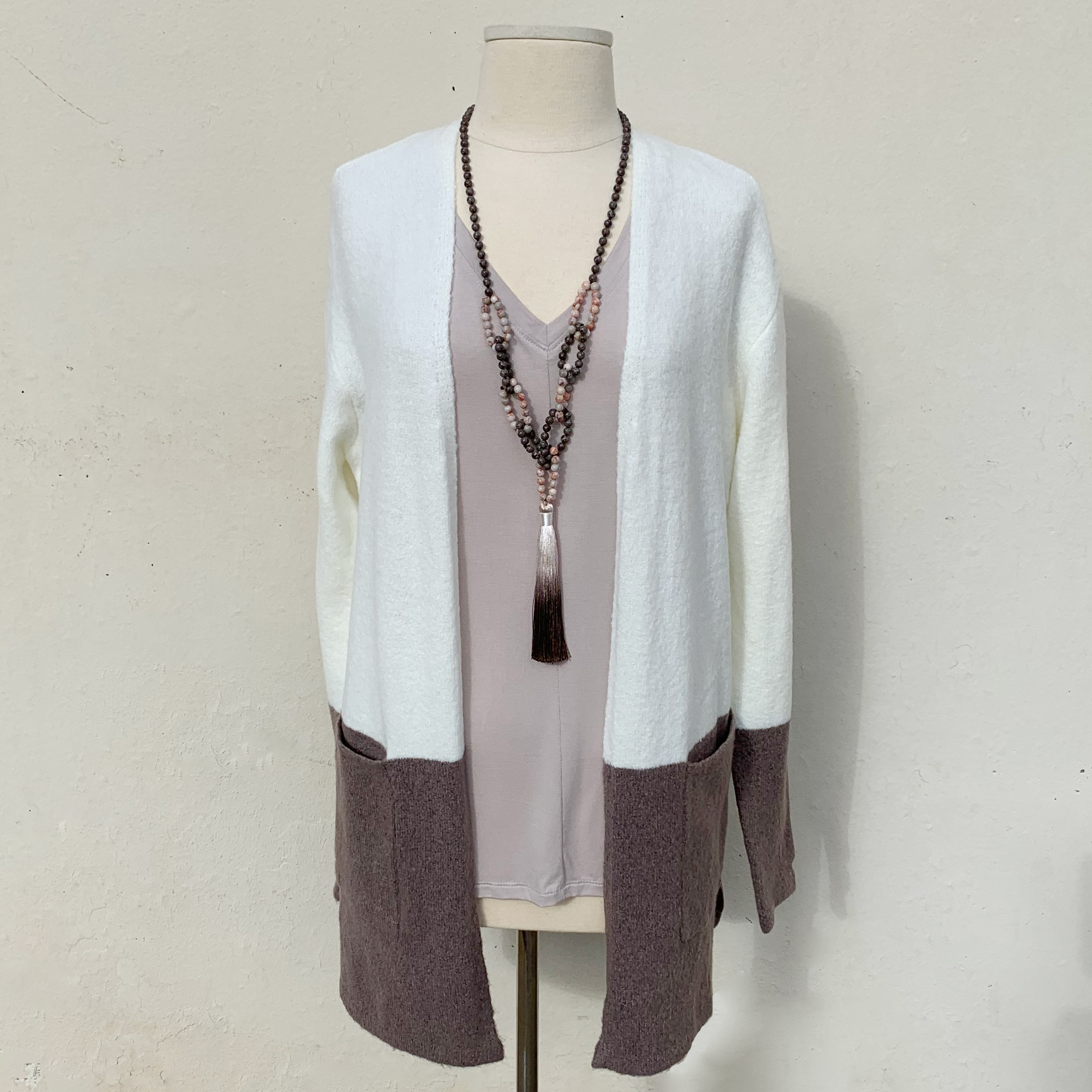 cream and taupe colorblock sweater with pockets