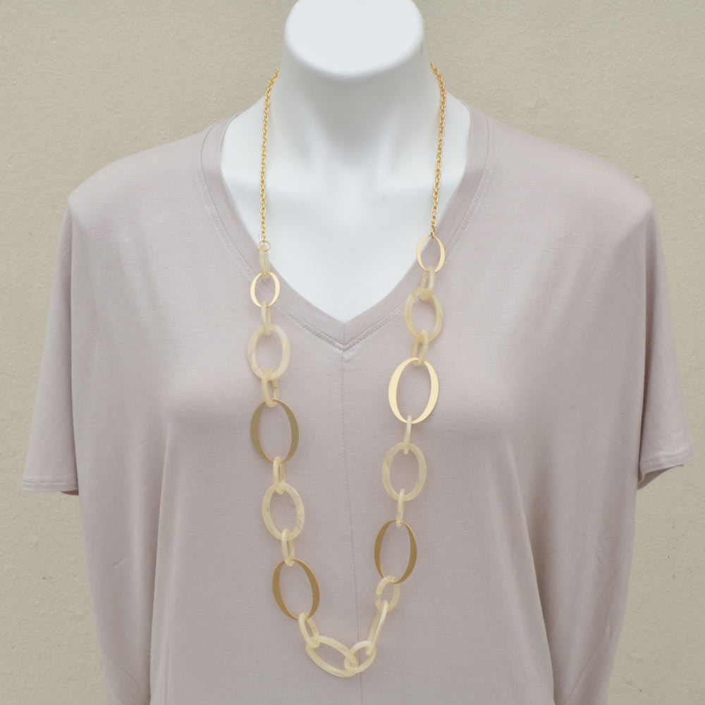 beige acrylic loop with gold necklace