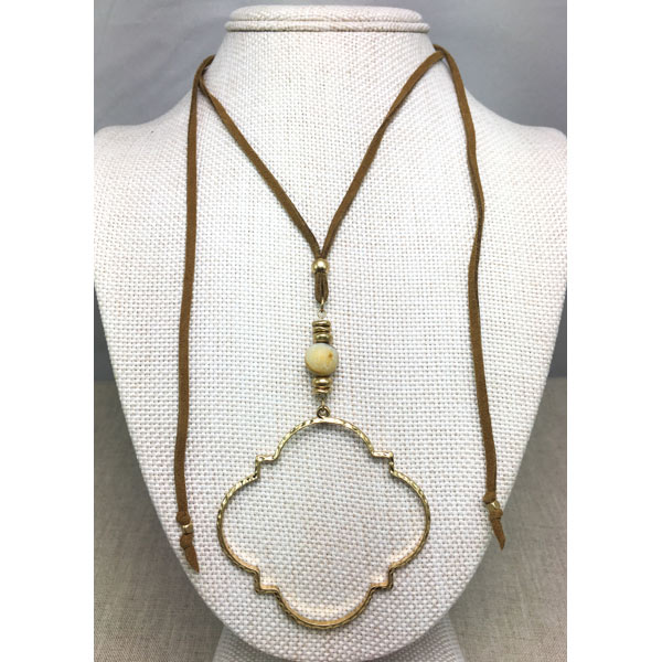 worn gold quatrefoil and leather necklace