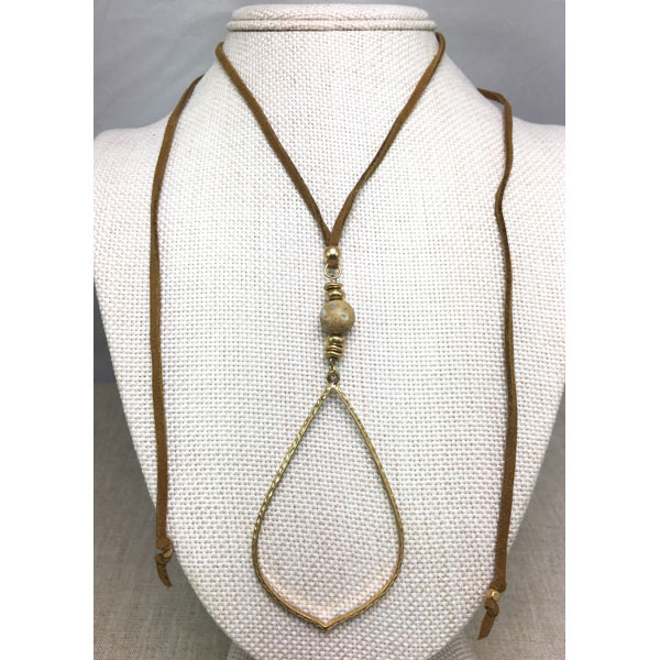 worn gold teardrop and leather necklace