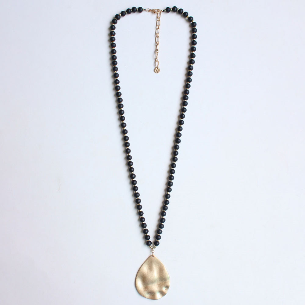 black wood beaded necklace with gold teardrop charm