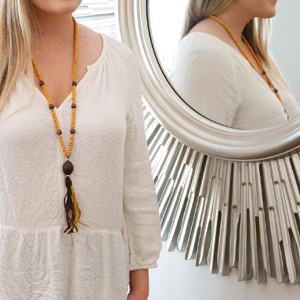 yellow necklace w/yellow and brown tassel