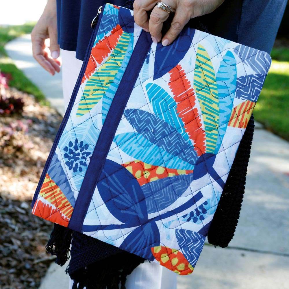 lei'd back quilted zipper bag