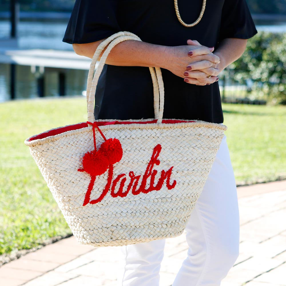 darlin' red straw tote with pom pom