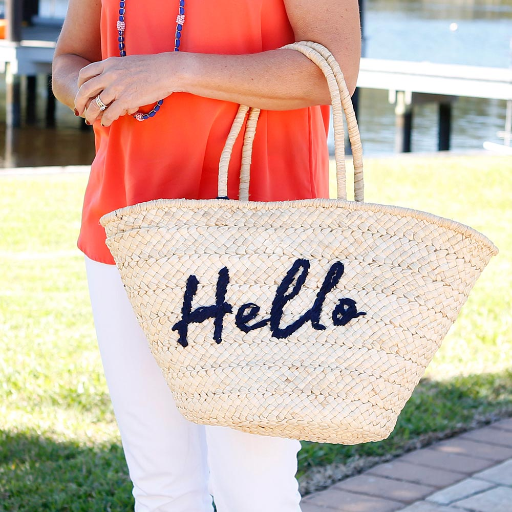 hello blue straw tote with pom pom