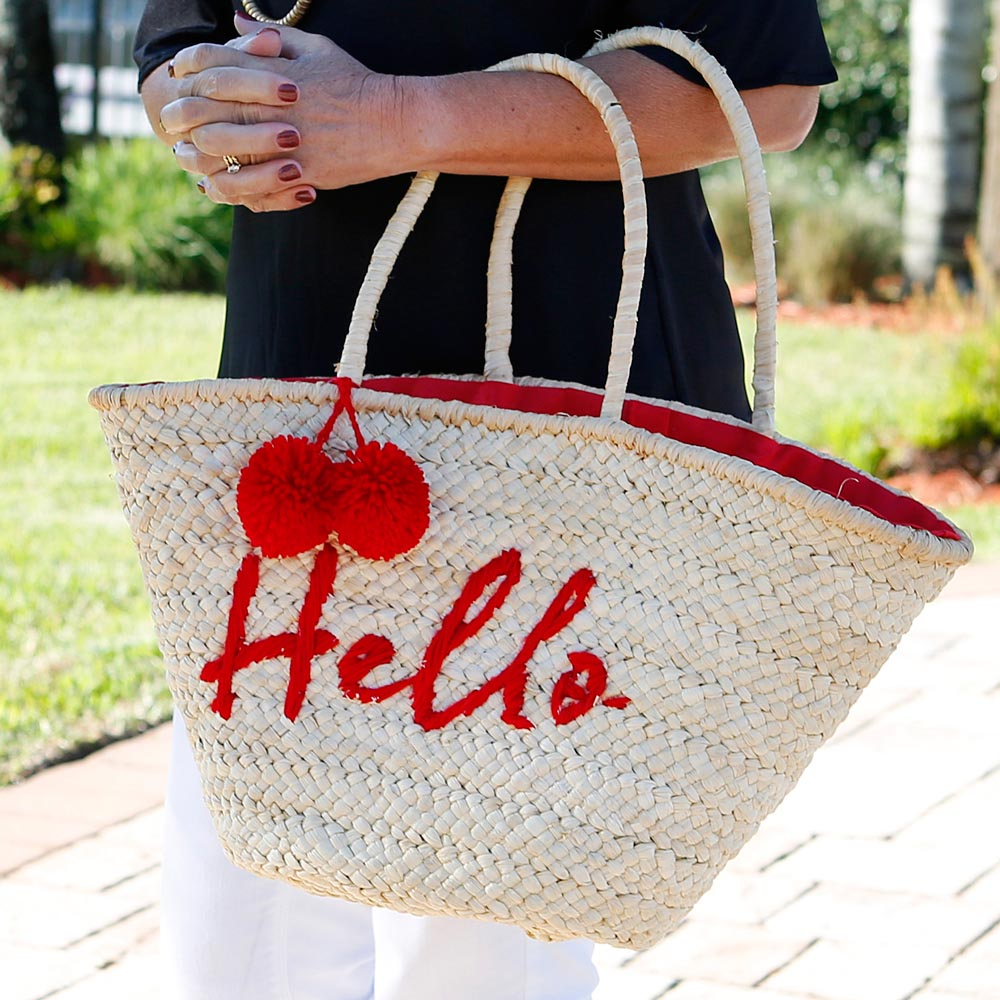hello red straw tote with pom pom