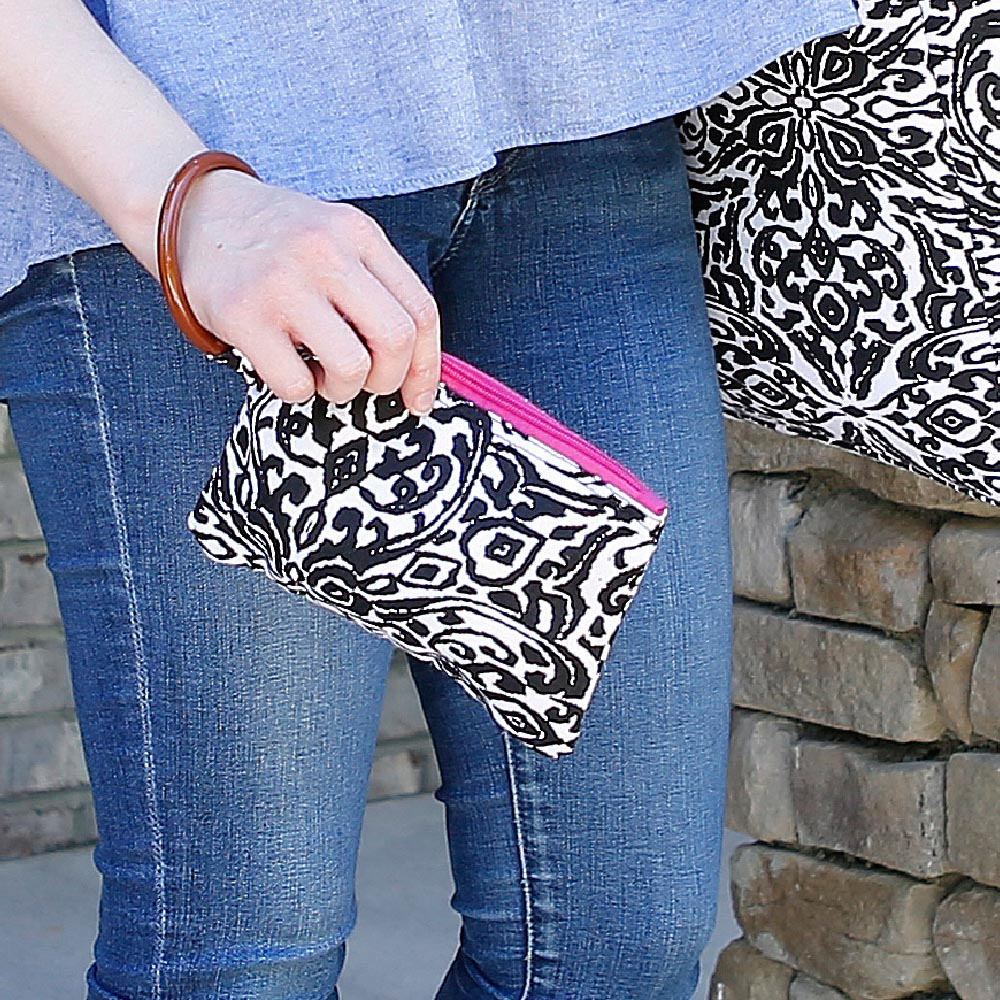 point blank black wristlet w/pink trim