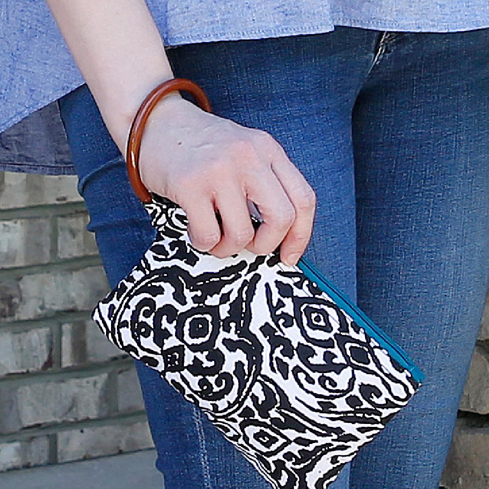 point blank black wristlet w/teal trim
